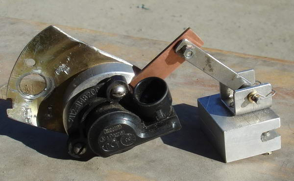 Автоматический электрокорректор наклона фар